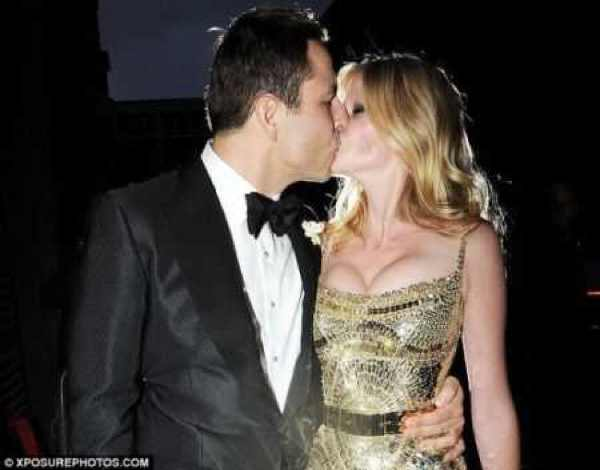 Lara Stone and David Williams kissing