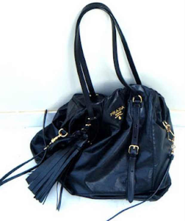 Prada black leather bag with tassel and gold details