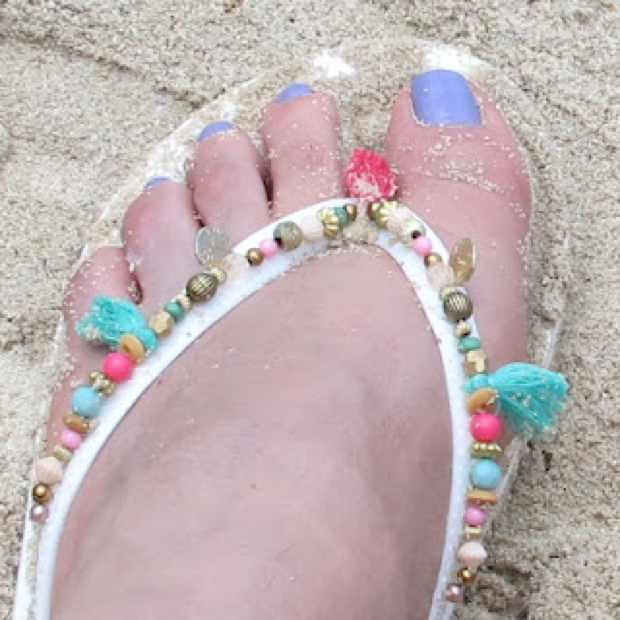 Accessorize beaded flip flops