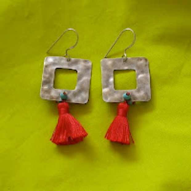 Earrings with red tassels