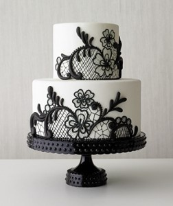 White wedding cake decorated with black lace