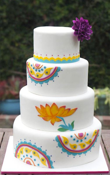 White wedding cake frosted and painted