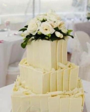Classic elegant wedding cake, 3 tier white chocolate wedding cake with white roses on top