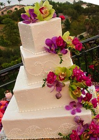 Tropical style square wedding cake with pink orchids