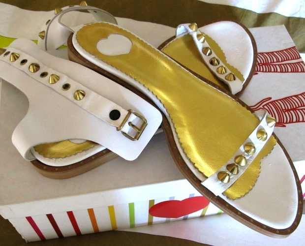 white flat sandals with gold studs