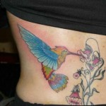 flower-feeding-tattoo-for-female