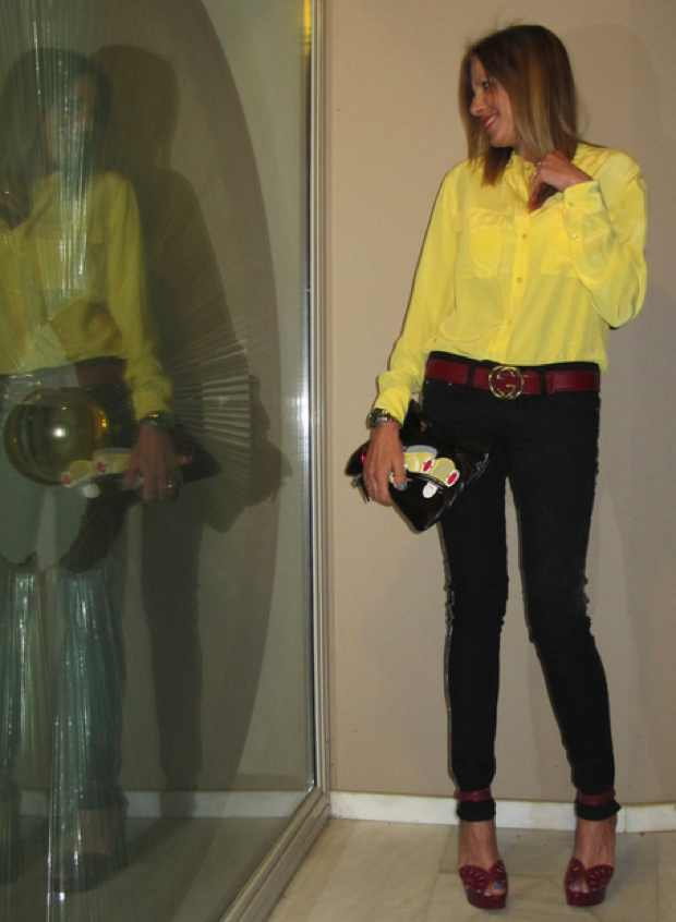 Equipment yellow shirt, Gucci belt, Isabel Marant pants, Alaia sandals