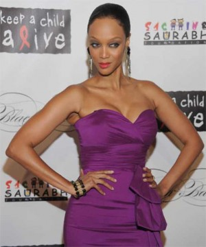 Tyra Banks purple fitted dress