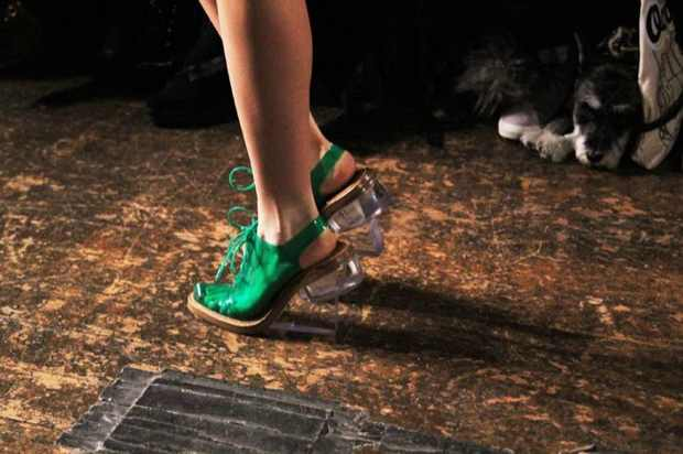 Green satin shoes with see-through plexiglass heels