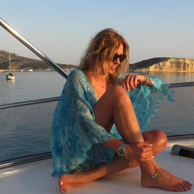 Turquoise cover up, yacht, Greece