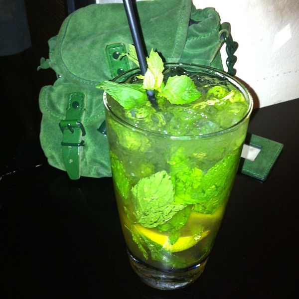 Mojito drink  and green suede mini Balenciaga