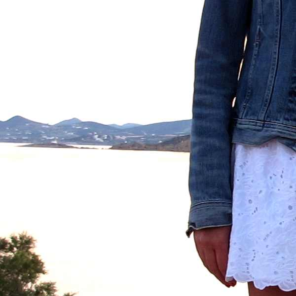 Paros white skirt blue jeans jacket Sea