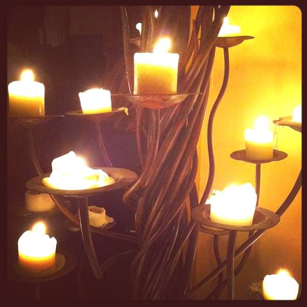 candles and iron candle holder