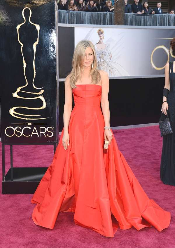 Jennifer Aniston in a Valentino dress, Salvatore Ferragamo clutch and Fred Leighton jewelry.