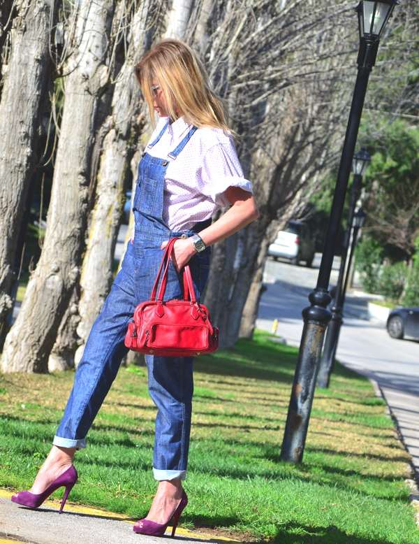 Denim Dungaree and Louboutins walking
