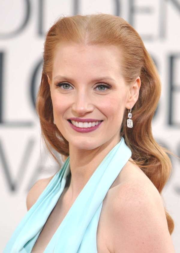 Jessica Chastain wears retro waves swept off the face,