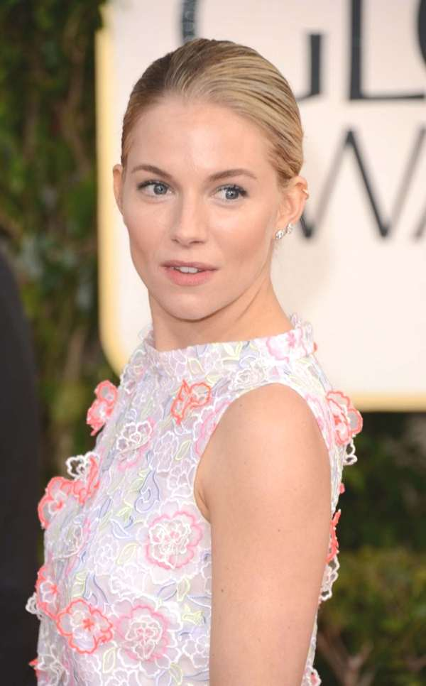 understated glamour, Sienna Miller chooses a sleek, knotted bun