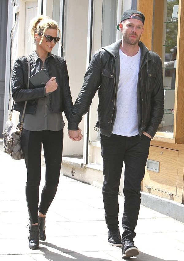 Sarah Harding and boyfriend Mark Foster in matching leather jackets. By the way Mark's hoodie under his men's leather jacket looks super cool