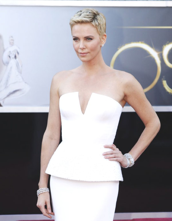 Charlize Theron at Oscars  wearing diamond bracelets
