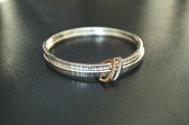 Hammered silver 2 strand bangle with gold and silver pendants Sallyanne Lowe