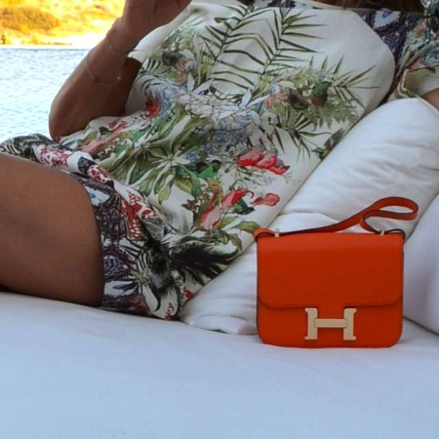 Hermes orange Constance bag, print dress