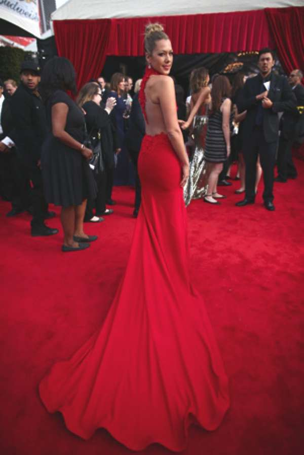 Colbie Caillat wearing a red gown by Ezra Santos at the 2014 Grammys