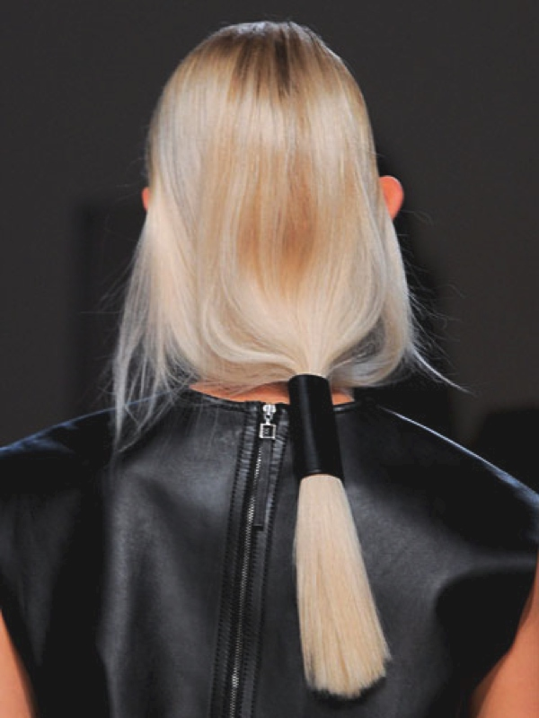 Helmut Lang, the low, loose ponytails were wrapped with a thick piece of leather