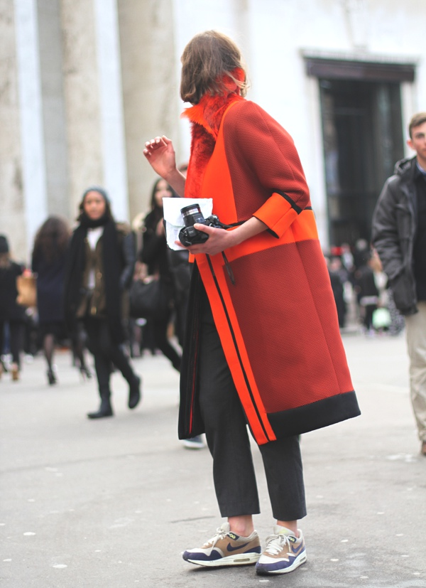 orange coat and athletic shoes
