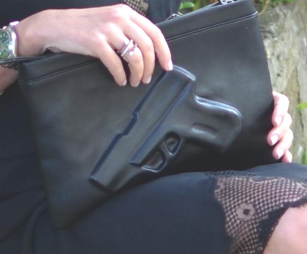 gun bag, rolex watch, stfan haffner ring