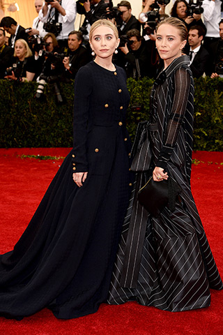 Ashley Olsen, in vintage Chanel, with Sidney Garber jewels, and Mary-Kate Olsen, in vintage Gianfranco Ferré