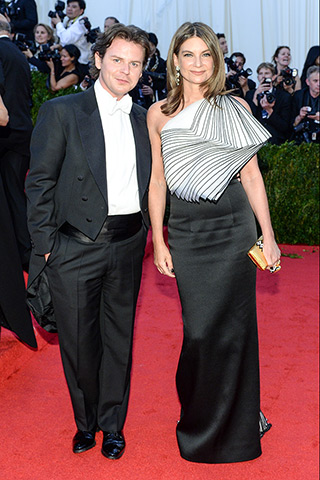 Christopher Kane and Natalie Massenet, in a custom gown by the designer