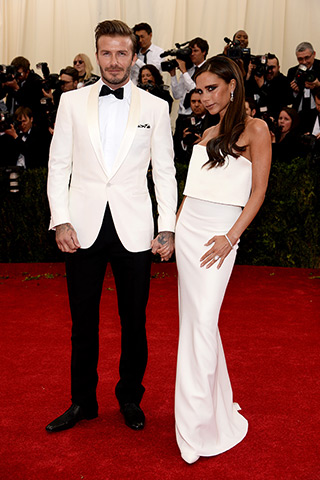 David Beckham, in Ralph Lauren, with Victoria Beckham, in her own design, with Jacob & Co. jewels