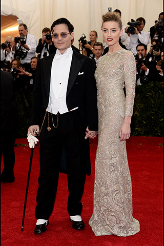 Johnny Depp, in Ralph Lauren, and Amber Heard, in Giambattista Valli Haute Couture, with Fred Leighton jewels.