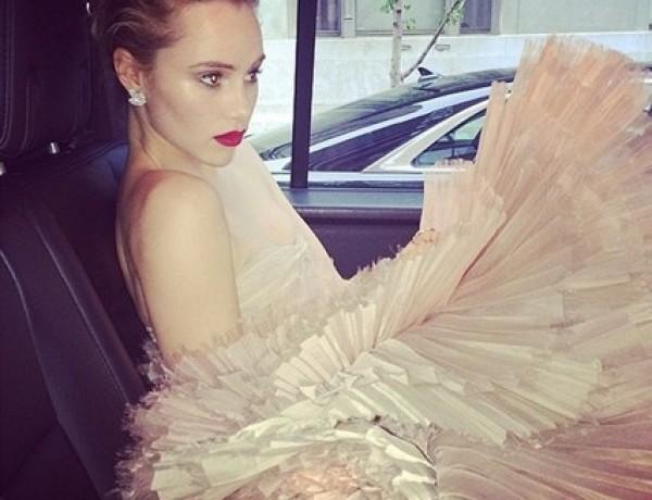 Suki Waterhouse makes her way to the Met Ball, where her boyfriend Bradley Cooper was a presenter.