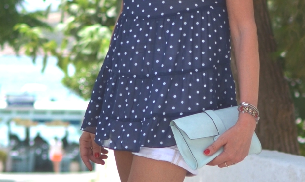 Polka dot top and Gap leather clutch