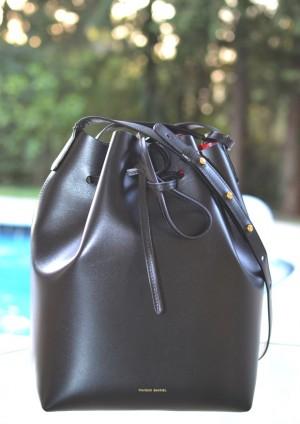 Glamour editor Laurel Pantin donning Birkenstocks and a Mansur Gavriel Black black with Flamma bucket bag.
