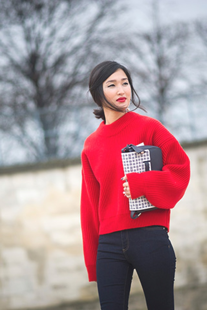 red chunky knit sweater and jeans