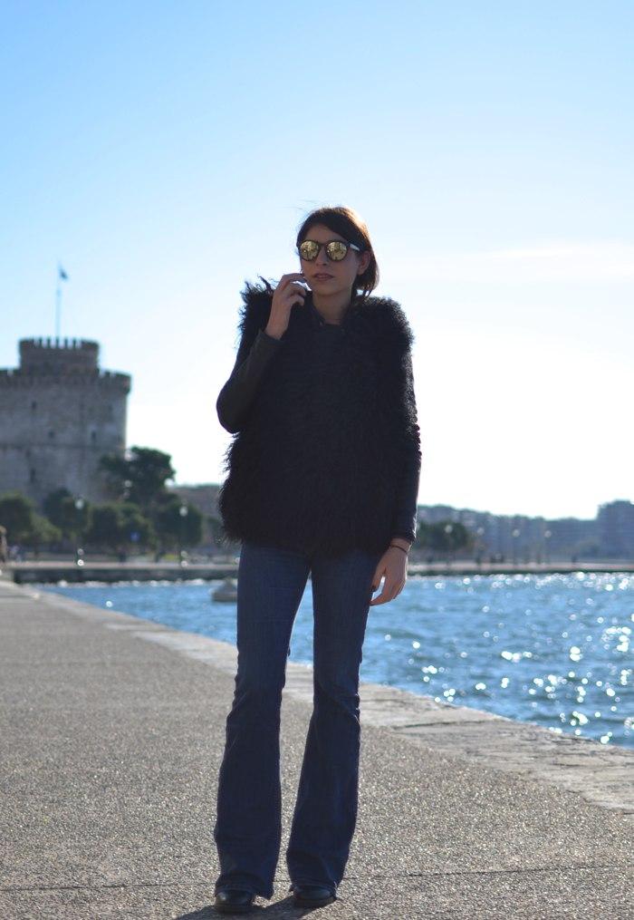 Niki Svolou Thessaloniki Winter Street Style Fur Mongolian vest, flare jeans