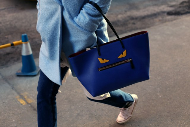 Blue pastel coat and Fendi monster tote bag