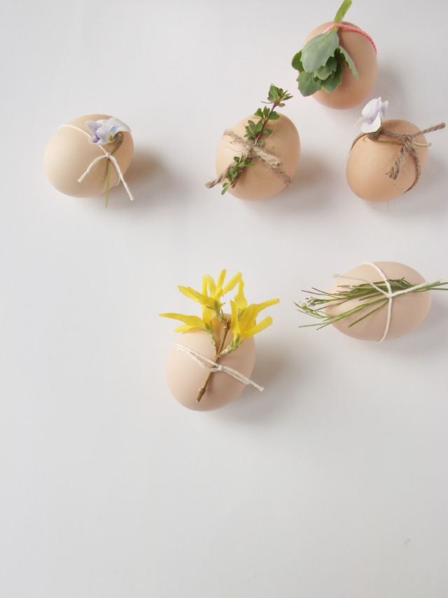tied flowers on Easter eggs