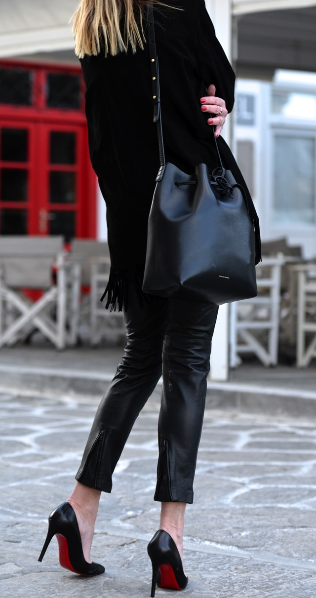Suede leather long fringed jacket, Mansur Gavriel bucket bag, Christian Louboutin Pigalle
