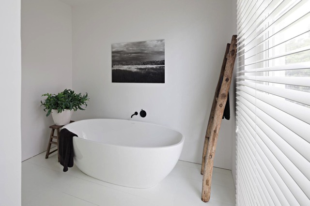 white bathtub wooden ladder