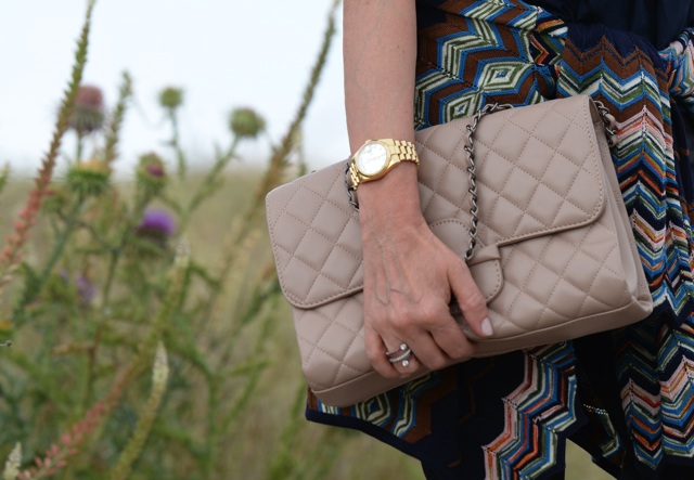 Chanel beige handbag Rolex gold