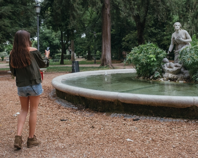 Niki photographing a marble statue Villa Borghese Rome