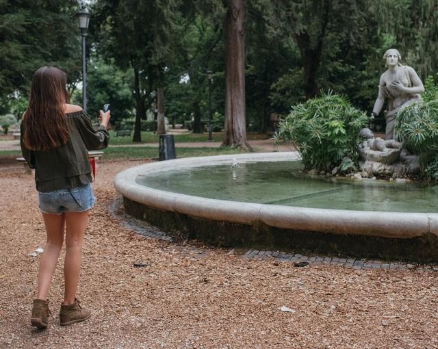 Niki photographing a marble statue Villa Borghese Rome