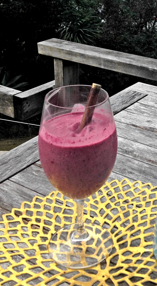 mixed berries smoothie in wine glass