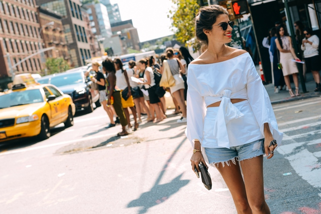 Leandra Medine white blouse cut off shorts