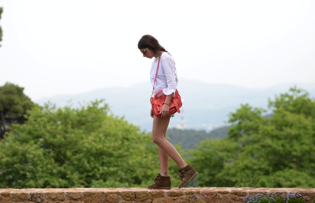 Niki Svolou summer vacation style- white ruffled blouse