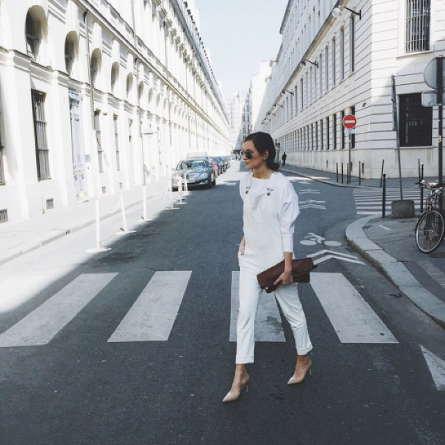 White jumpsuit with nude accessories