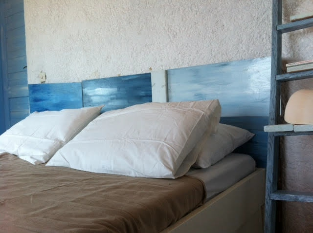 Summer house bedroom DIY blue painted headboard